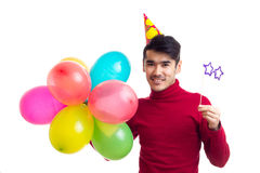 De ballons van de jonge mensenholding Stock Foto