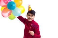 De ballons van de jonge mensenholding Stock Afbeelding