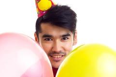 De ballons van de jonge mensenholding Royalty-vrije Stock Fotografie
