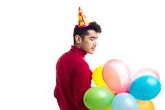 De ballons van de jonge mensenholding Royalty-vrije Stock Afbeelding