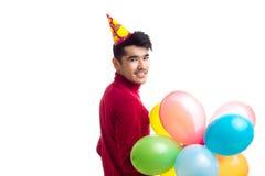 De ballons van de jonge mensenholding Stock Foto's