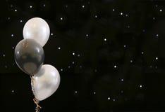 De ballons van de partij op zwarte Royalty-vrije Stock Foto