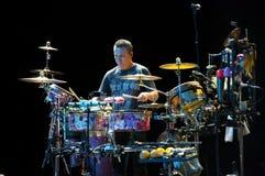 De band van Carlos Santana's: Karl Perazzo Stock Foto's