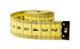 De band van de centimeterkleermaker op een wit ge?soleerde achtergrond Close-up royalty-vrije stock afbeeldingen