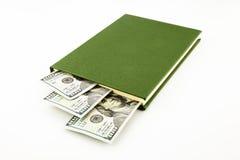 De bankbiljetten en het boek van het dollargeld stock afbeeldingen