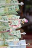 De bankbiljetten in maken verdienste van Thais boeddhisme royalty-vrije stock foto's