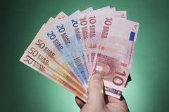 De bankbiljetten van de handholding Stock Fotografie
