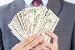 De bankbiljetten van de zakenmanholding op witte achtergrond royalty-vrije stock afbeelding