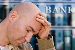 De bankier van de investering in wanhoop Royalty-vrije Stock Foto's