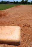 De basiszak van het honkbal op infield Stock Afbeeldingen
