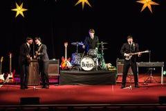 De Beatles-Heropleving die op 23 van December presteren stock fotografie
