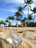 De bedelaars en de diamant van het strand Stock Foto