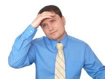 De bedrijfs mens denkt van hem een probleem na Royalty-vrije Stock Foto