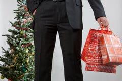 De bedrijfs mens met Kerstmis stelt 2 voor Stock Afbeeldingen