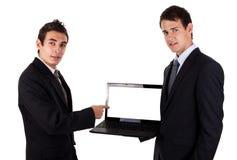 De bedrijfs mens toont op lege laptop Royalty-vrije Stock Fotografie