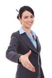 De bedrijfs vrouw geeft een handdruk stock fotografie