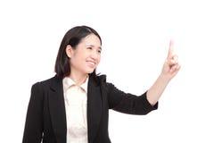 De bedrijfs vrouw richt vinger op iets Royalty-vrije Stock Fotografie