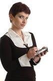 De bedrijfs vrouwen plaatsen haar planner Stock Afbeeldingen
