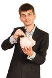 De bedrijfsmens bespaart geld Royalty-vrije Stock Afbeelding
