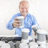 De bedrijfsmens drinkt teveel koffie Royalty-vrije Stock Foto