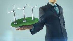 De bedrijfsmens heeft op hand het groene energieconcept animatiewindmolen bouwt vector illustratie