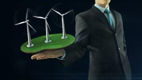 De bedrijfsmens heeft op hand het groene energieconcept de zwarte van de animatiewindmolen bouwt royalty-vrije illustratie