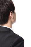 De bedrijfsmens kijkt exemplaarruimte van rug Stock Fotografie