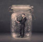 De bedrijfsmens ving in glaskruik met hand getrokken media pictogrammen c royalty-vrije stock foto's