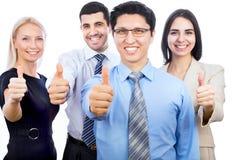 De bedrijfsmensen die duimen tonen ondertekenen omhoog Stock Foto