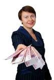De bedrijfsvrouw geeft geld Royalty-vrije Stock Afbeelding
