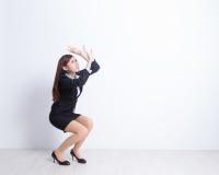 De bedrijfsvrouw vreest iets royalty-vrije stock foto's