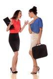 De bedrijfsvrouwen… en uw vinger zijn omhoog Stock Foto