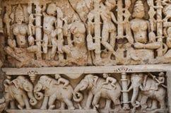 De Beeldhouwwerkendetails van de steenmuur van gfw w Stock Afbeeldingen