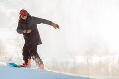 De beginner snowboarder De ruimte van het exemplaar stock afbeelding
