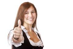 De Beierse vrouw met kleding Dirndl toont duim Stock Afbeeldingen
