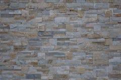 De beige achtergrond van de steenmuur Stock Foto's