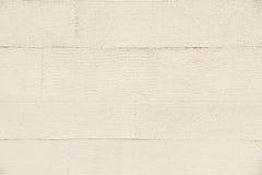 De beige gestreepte achtergrond van de muurtextuur Royalty-vrije Stock Fotografie