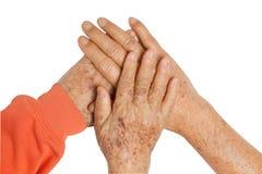 De bejaarde handen van de paarholding stock foto