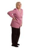 De bejaarde met een pijn in een rug Stock Afbeeldingen