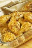 De benen van de kip in saus Stock Fotografie
