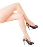 De benen van de vrouw op witte achtergrond Royalty-vrije Stock Foto