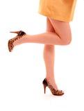 De benen van de vrouw in schoenen stock fotografie