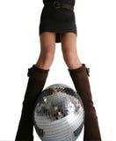 De benen van meisjes en glitterball Stock Foto