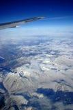 De berg van de sneeuw van vliegtuig Stock Foto