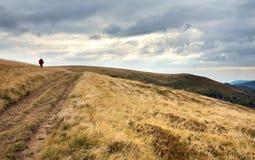 De bergen van de fotograaf en van de herfst stock afbeeldingen