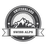 De Bergenzegel van alpen - het etiket van Zwitserland Stock Foto