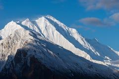 De bergpiek van de Rakaposhisneeuw bij Hunza-vallei, Gilgit Baltistan, Stock Fotografie