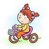 De berijdende driewieler van het babymeisje Royalty-vrije Stock Foto