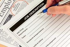 De Beschrijving van de baan en Hand met Pen stock foto