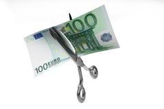 De besnoeiing van het geld Stock Foto